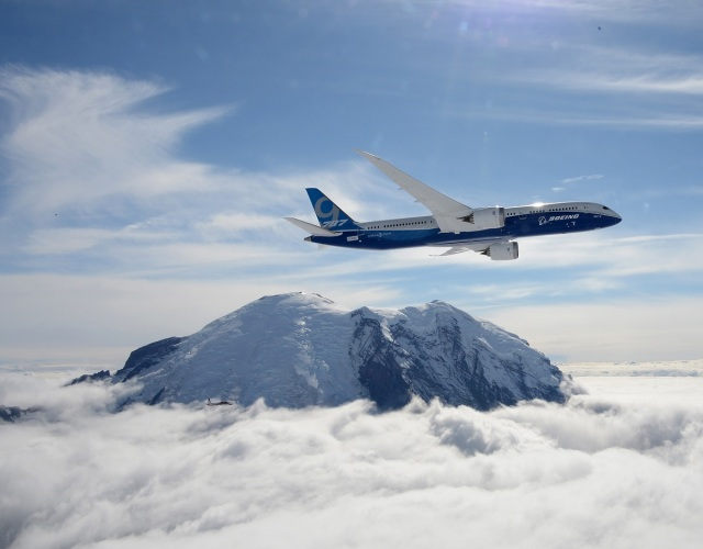 Image: 787 jet flies over Mount Rainier