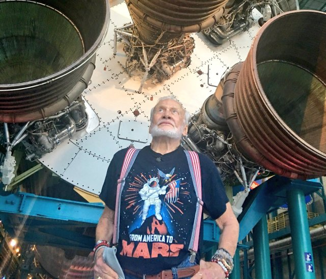 "Apollo 11 moonwalker Buzz Aldrin check out the engines on a Saturn V rocket at Kennedy Space Center in Florida. ""I'm feeling better and my rocket is ready to launch,"" he tweeted. (Buzz Aldrin Photo via Twitter)"