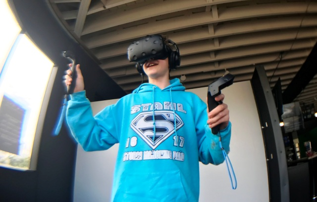 Teen playing virtual reality game